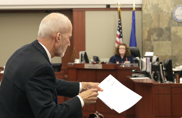 Attorney Joseph Kistler asks District Judge Gloria Sturman to extend an order freezing financial accounts of suspended probate lawyer Robert Graham at the Regional Justice Center on Wednesday, Dec ...