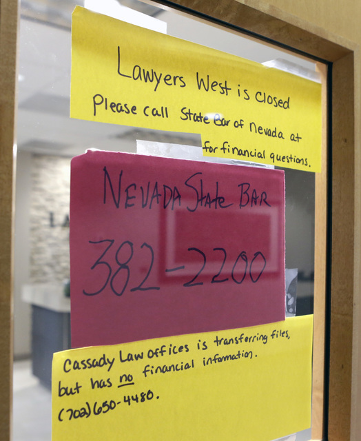 Office closure notices on the main door of Robert Graham's office at Lawyers West on 10000 W. Charleston Blvd. Friday, Dec. 9, 2016, in Las Vegas. Graham has abandoned his law practice and stolen  ...