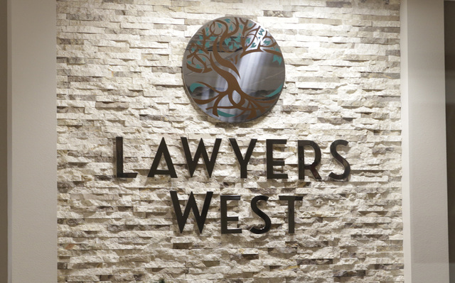 Lawyers West sign inside Robert Graham's office on 10000 W. Charleston Blvd. Friday, Dec. 9, 2016, in Las Vegas. Graham has abandoned his law practice and may have stolen millions of dollars. (Biz ...