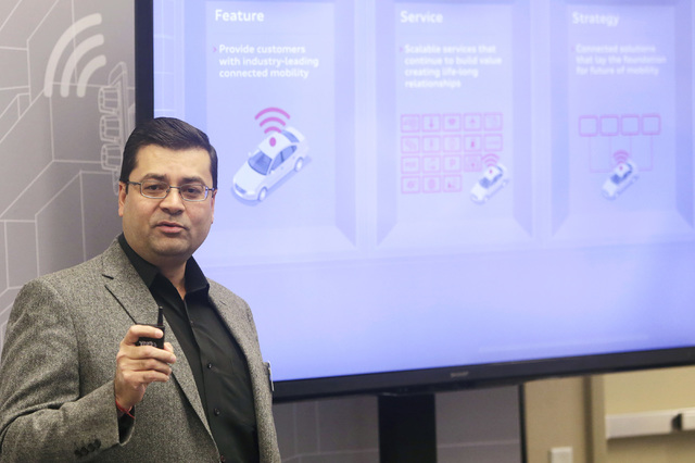 Anupam Malhotra, director of connected vehicles for Audi America, talks about Audi connect during a demonstration on a countdown timer for red lights, Tuesday, Dec.6, 2016, at RTC Traffic Manageme ...
