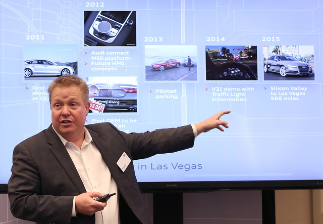 Mark Dahncke, senior manager product and motorsports communications at Audi, talks about Audi's history of innovation during a demonstration on a countdown timer for red lights, Tuesday, Dec.6, 20 ...