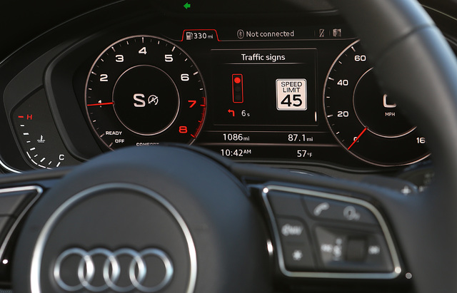 A countdown timer for red lights is displayed on the instrument panel during the test drive of Audi A4, Tuesday, Dec.6, 2016, in Las Vegas. Audi of America for the first Vehicle-to-Infrastructure  ...