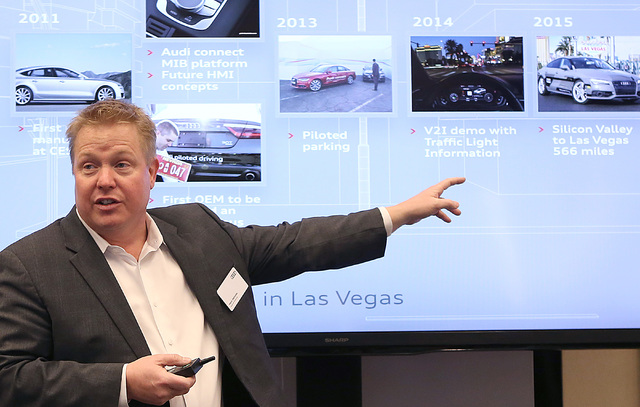Mark Dahncke, senior manager product and motorsports communications at Audi, talks about Audi's history of innovation during a demonstration on a countdown timer for red lights Tuesday, Dec.6, 201 ...