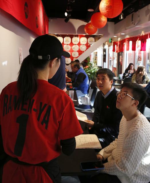 A waitress takes a customer's order at Ramen-ya at the Grand Bazaar Shops in Las Vegas on Friday, Dec. 2, 2016. (David Guzman/Las Vegas Review-Journal) @DavidGuzman1985