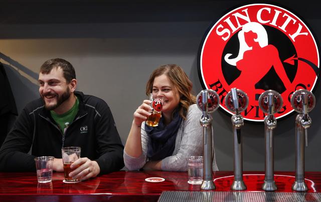 Kyle and Tracy Brown of Snohomish, Washington enjoy a beer at Sin City Brewing Co. at the Grand Bazaar Shops in Las Vegas on Friday, Dec. 2, 2016. (David Guzman/Las Vegas Review-Journal) @DavidGuz ...
