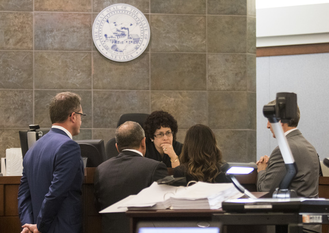 Attorneys approach judge Elissa Cadish during a death penalty trial for Norman Belcher at the Regional Justice Center in Las Vegas, on Friday, Dec. 2, 2016. Belcher, 41, is charged with killing hi ...