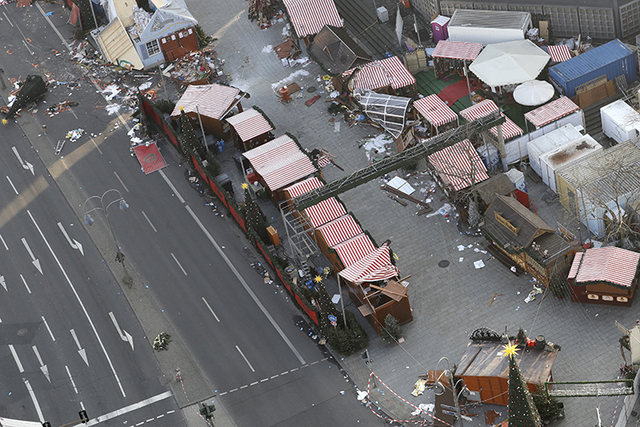 Debris still lies on the crime scene in Berlin, Germany, Wednesday, Dec. 21, 2016, two days after a truck ran into a crowded Christmas market and killed several people. (Michael Sohn/AP)