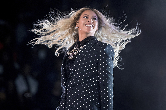 Beyonce performs at a Get Out the Vote concert for Democratic presidential candidate Hillary Clinton in Cleveland. The pop star leads the 2017 Grammys with nine nominations. (Andrew Harnik/AP)