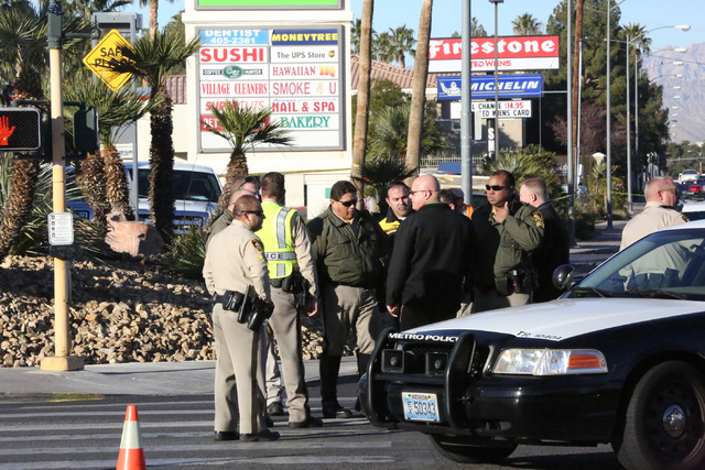 Police gather at the intersection of Eastern and Warm Springs where a person on bicycle was hit and killed on Thursday, December 29, 2016. (Michael Quine/Review-Journal) @Vegas88s