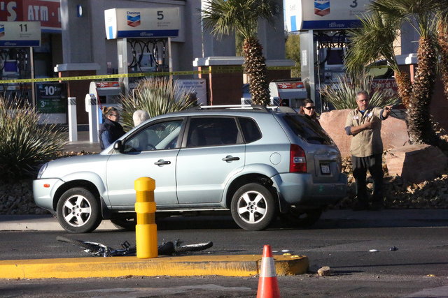A man points to where a person on bicycle was hit and killed at the intersection of Eastern and Warm Springs on Thursday, December 29, 2016. (Michael Quine/Review-Journal) @Vegas88s