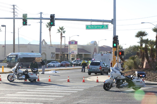 Police investigate an accident at the intersection of Eastern and Warm Springs where a person on bicycle was hit and killed on Thursday, December 29, 2016. (Michael Quine/Review-Journal) @Vegas88s