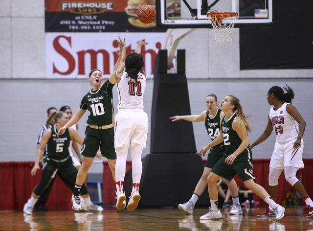 UNLV guard Dylan Gonzalez (11) goes up to score a three-pointer against Colorado State during a basketball game at Cox Pavilion in Las Vegas on Thursday, Dec. 29, 2016. (Chase Stevens/Las Vegas Re ...
