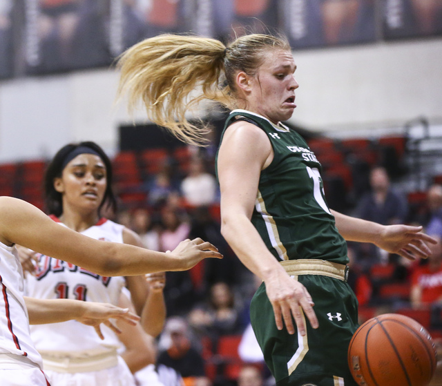 Colorado State guard/forward Callie Kaiser (12) reacts while attempting to gain control of a rebound over UNLV during a basketball game at Cox Pavilion in Las Vegas on Thursday, Dec. 29, 2016. (Ch ...