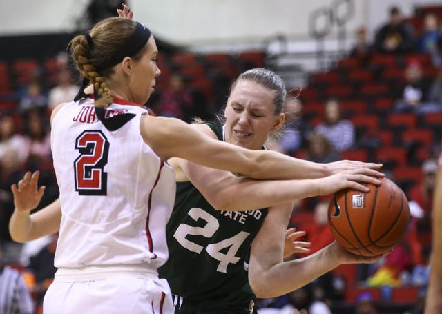 UNLV guard Brooke Johnson (2) defends against Colorado State forward Amanda Kantzy (24) during a basketball game at Cox Pavilion in Las Vegas on Thursday, Dec. 29, 2016. (Chase Stevens/Las Vegas R ...