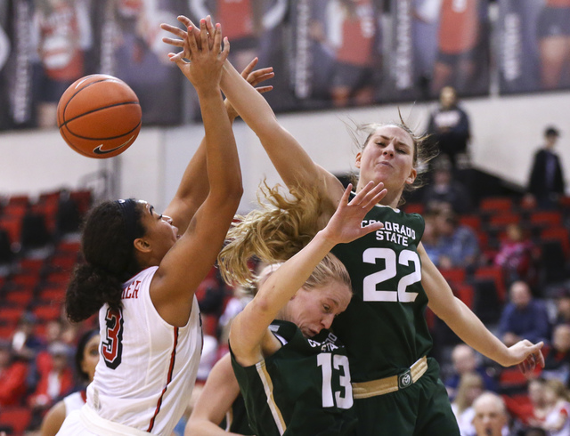 UNLV forward Paris Strawther (3) fights for a rebound against Colorado State guard Ellen Nystrom (13) and forward Elin Gustavsson (22) during a basketball game at Cox Pavilion in Las Vegas on Thur ...
