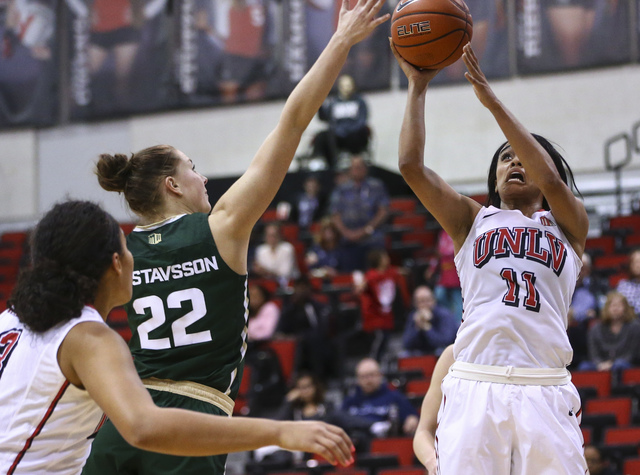 UNLV guard Dylan Gonzalez (11) goes up to score a shot as Colorado State forward Elin Gustavsson (22) defends during a basketball game at Cox Pavilion in Las Vegas on Thursday, Dec. 29, 2016. UNLV ...