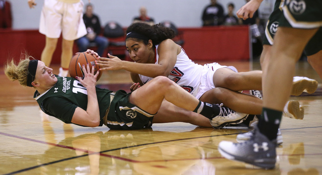 Colorado State guard Hannah Tvrdy (10) and UNLV forward Paris Strawther (3) fight for possession of the ball during a basketball game at Cox Pavilion in Las Vegas on Thursday, Dec. 29, 2016. UNLV  ...