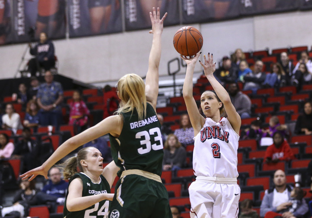 UNLV guard Brooke Johnson (2) shoots as Colorado State center Anna Dreimane (33) defends during a basketball game at Cox Pavilion in Las Vegas on Thursday, Dec. 29, 2016. UNLV lost 57-37. (Chase S ...
