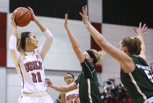 UNLV center Katie Powell (21) looks for an open pass while playing against Colorado State in a basketball game at Cox Pavilion in Las Vegas on Thursday, Dec. 29, 2016. UNLV lost 57-37. (Chase Stev ...