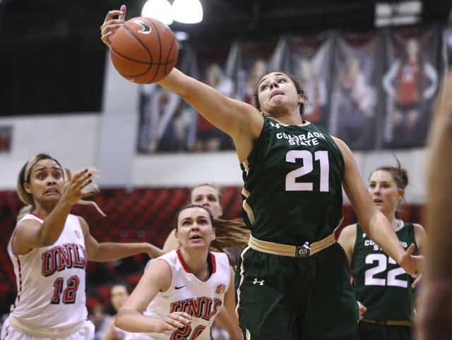 Colorado State Rams guard/forward Myanne Hamm (21) gets a rebound over UNLV during a basketball game at Cox Pavilion in Las Vegas on Thursday, Dec. 29, 2016. UNLV lost 57-37. (Chase Stevens/Las Ve ...