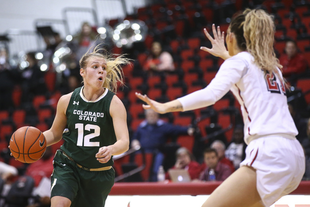Colorado State guard/forward Callie Kaiser (12) drives against UNLV center Katie Powell (21) during a basketball game at Cox Pavilion in Las Vegas on Thursday, Dec. 29, 2016. (Chase Stevens/Las Ve ...