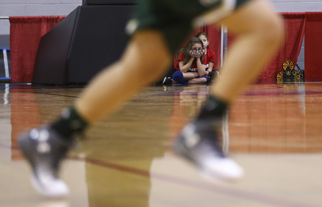 A young court attendant looks on as UNLV plays Colorado State in a basketball game at Cox Pavilion in Las Vegas on Thursday, Dec. 29, 2016. (Chase Stevens/Las Vegas Review-Journal) @csstevensphoto