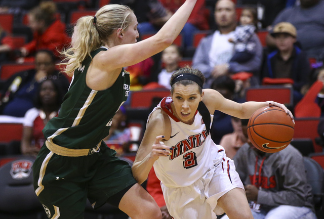 UNLV guard Brooke Johnson (2) drives against Colorado State guard Ellen Nystrom (13) during a basketball game at Cox Pavilion in Las Vegas on Thursday, Dec. 29, 2016. UNLV lost 57-37. (Chase Steve ...