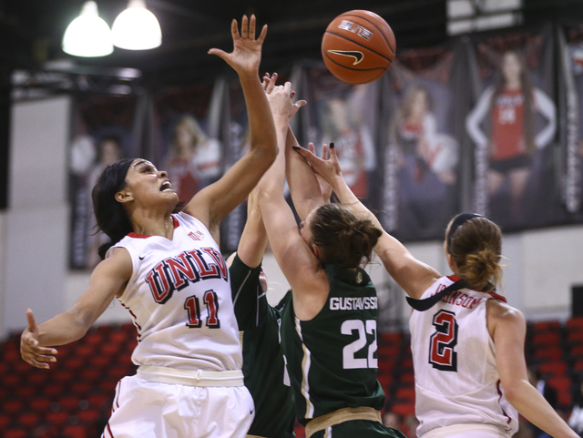 UNLV guards Dylan Gonzalez (11) and Brooke Johnson (2) go up for a rebound against Colorado State during a basketball game at Cox Pavilion in Las Vegas on Thursday, Dec. 29, 2016. UNLV lost 57-37. ...