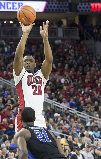 UNLV's Christian Jones (20) shoots over Duke's Amile Jefferson (21) during the Blue Devils road matchup with the Rebels at T-Mobile Arena on Saturday, Dec. 10, 2016, in Las Vegas. (Benjamin Hager/ ...