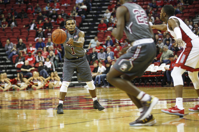 Southern Illinois Salukis guard Mike Rodriguez (1) passes the ball during a game against UNLV at the Thomas & Mack Center on Monday, Dec. 19, 2016 in Las Vegas. (Rachel Aston/Las Vegas Review- ...