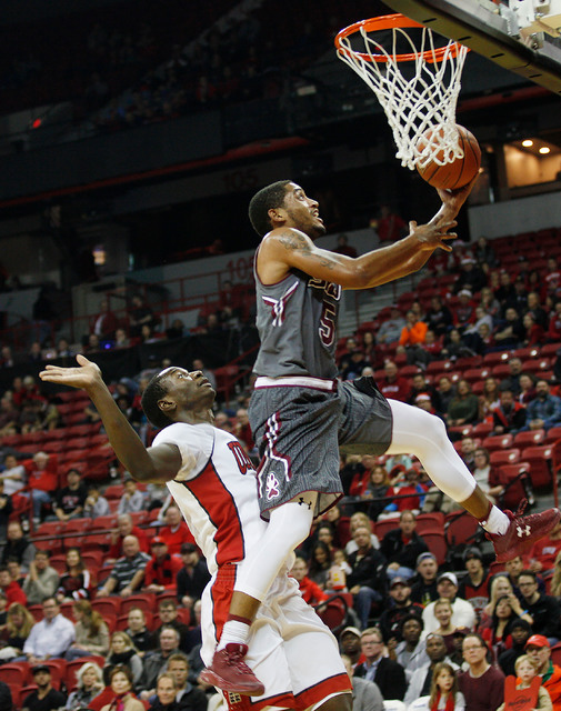 Southern Illinois Salukis guard Leo Vincent (5) passes UNLV Rebels forward Cheickna Dembele (11) to shoot during a game against Southern Illinois at the Thomas & Mack Center on Monday, Dec. 19 ...