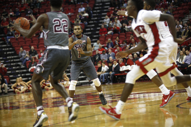 Southern Illinois Salukis guard Mike Rodriguez (1) passes to teammate Southern Illinois Salukis guard Armon Fletcher (22) during a game against the UNLV Rebels at the Thomas & Mack Center on M ...