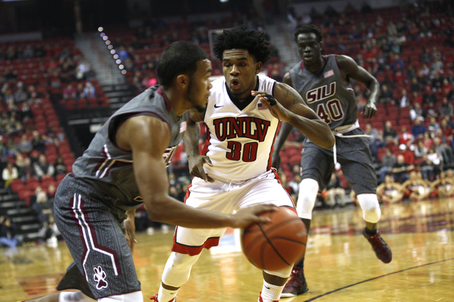 Southern Illinois Salukis guard Mike Rodriguez (1) attempts to slip past UNLV Rebels guard Jovan Mooring (30) during a game at the Thomas & Mack Center on Monday, Dec. 19, 2016, in Las Vegas.  ...