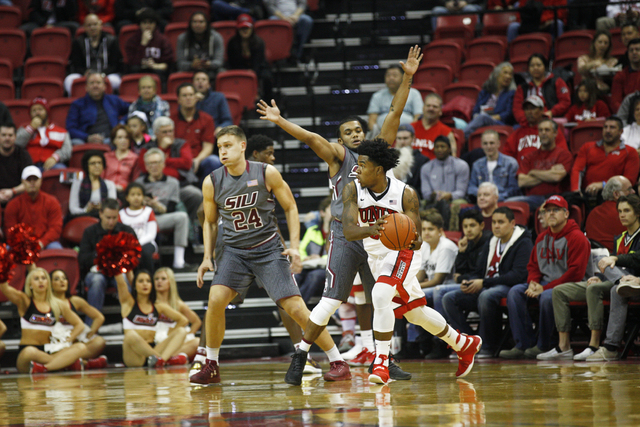 UNLV Rebels guard Jovan Mooring (30) attempts to pass Southern Illinois Salukis forward Rudy Stradnieks (24) and Southern Illinois Salukis (1) during a game at the Thomas & Mack Center on Mond ...