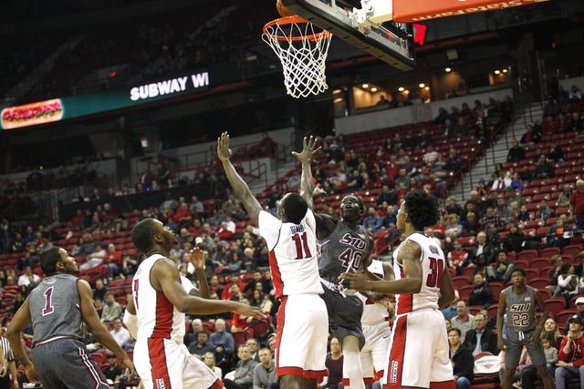 Both the UNLV Rebels and Southern Illinois Salukis wait to catch a rebound during a game at the Thomas & Mack Center on Monday, Dec. 19, 2016, in Las Vegas. (Rachel Aston/Las Vegas Review-Jour ...