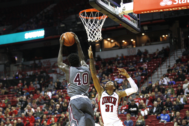 Southern Illinois Salukis forward Thik Bol (40) goes to shoot against UNLV Rebels forward Troy Baxter Jr. (31) during a game at the Thomas & Mack Center on Monday, Dec. 19, 2016, in Las Vegas. ...