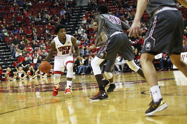UNLV Rebels guard Jovan Mooring (30) dribbles past opponents during a game against the Southern Illinois Salukis at the Thomas & Mack Center on Monday, Dec. 19, 2016, in Las Vegas. (Rachel Ast ...
