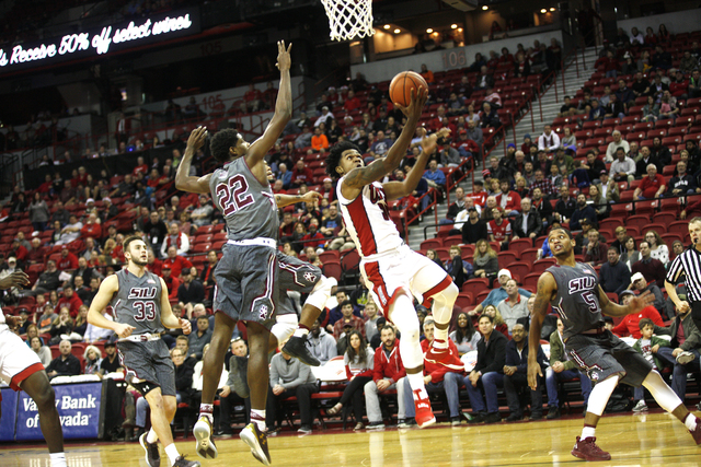 UNLV Rebels guard Jovan Mooring (30) goes to shoot against Southern Illinois Salukis guard Armon Fletcher (22) during a game at the Thomas & Mack Center on Monday, Dec. 19, 2016, in Las Vegas. ...