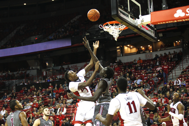 UNLV Rebels guard Kris Clyburn (1) goes to shoot against  Illinois Salukis forward Thik Bol (40) during a game at the Thomas & Mack Center on Monday, Dec. 19, 2016, in Las Vegas. (Rachel Aston ...