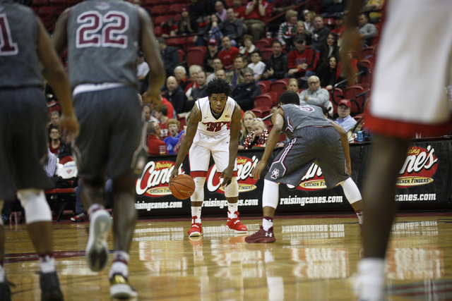 UNLV Rebels guard Jovan Mooring (30) prepares to dribble past opponents during a game against the Southern Illinois Salukis at the Thomas & Mack Center on Monday, Dec. 19, 2016, in Las Vegas.  ...