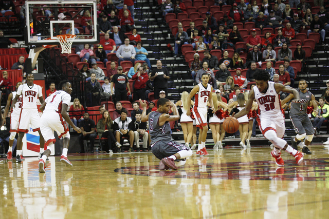 UNLV Rebels guard Jovan Mooring (30)  steals the ball from Southern Illinois Salukis guard Leo Vincent (5) during a game at the Thomas & Mack Center on Monday, Dec. 19, 2016, in Las Vegas. (Ra ...