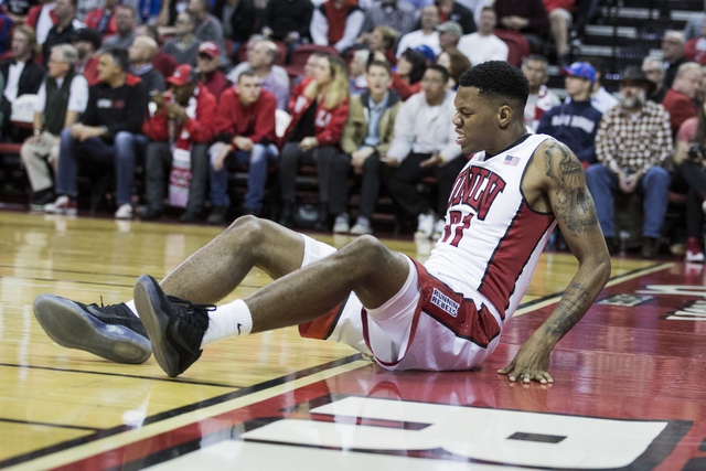 UNLV forward Troy Baxter Jr. grimaces after landing awkwardly on his knee in the Rebels' 71-53 loss to No. 3 Kansas at the Thomas & Mack Center on Thursday, Dec. 22, 2016. He is scheduled to h ...