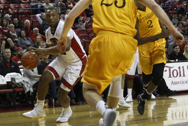 UNLV forward Christian Jones (20) drives towards the hoop during the first half of a NCAA college basketball game against Wyoming at the Thomas & Mack Center on Saturday, Dec. 31, 2016, in Las ...