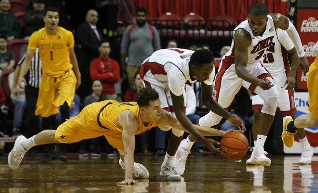 UNLV guard Kris Clyburn (1) recovers a loose ball during the second half of a NCAA college basketball game against Wyoming at the Thomas & Mack Center on Saturday, Dec. 31, 2016, in Las Vegas. ...