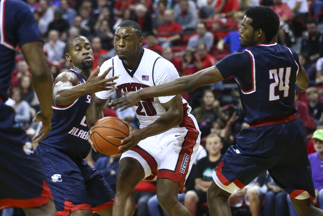 South Alabama forwards Don MuepoKelly (25) and Nick Stover (24) defend against UNLV forward Christian Jones (20) during a basketball game at the Thomas & Mack Center in Henderson on Friday, No ...