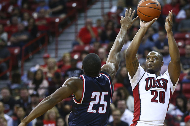 UNLV forward Christian Jones (20) shoots over South Alabama forward Don MuepoKelly (25) during a basketball game at the Thomas & Mack Center in Henderson on Friday, Nov. 11, 2016. South Alabam ...