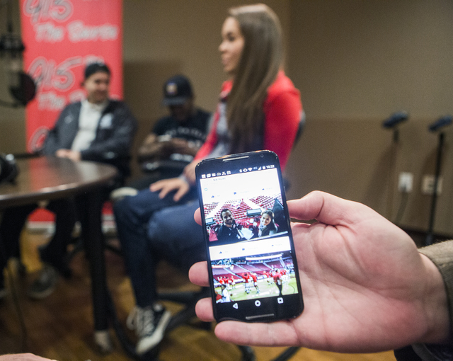 Frank Mueller, general manager of KUNV 91.5 and an instructor at Hank Greenspan School of Journalism, shows photos of UNLV students broadcasting live during a Rebels basketball game during an inte ...
