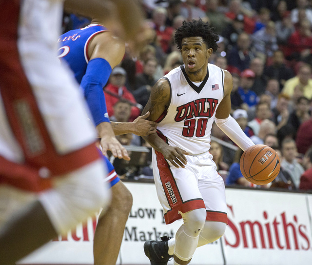 UNLV guard Jovan Mooring looks for an opening during first half against the Kansas Jayhawks at the Thomas and Mack Center on Thursday, Dec. 22, 2016. Kansas defeated the Rebels, 71-53. (Jeff Schei ...