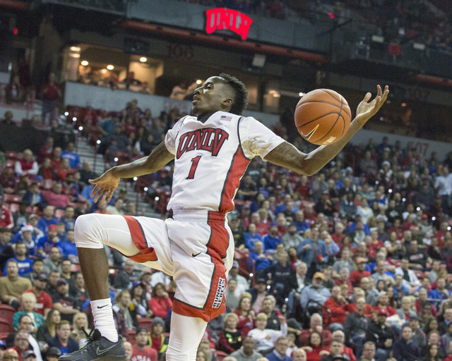 UNLV guard Kris Clyburn completes a dunk during the first half against the Kansas Jayhawks at the Thomas and Mack Center on Thursday, Dec. 22, 2016. Kansas defeated the Rebels, 71-53. (Jeff Scheid ...