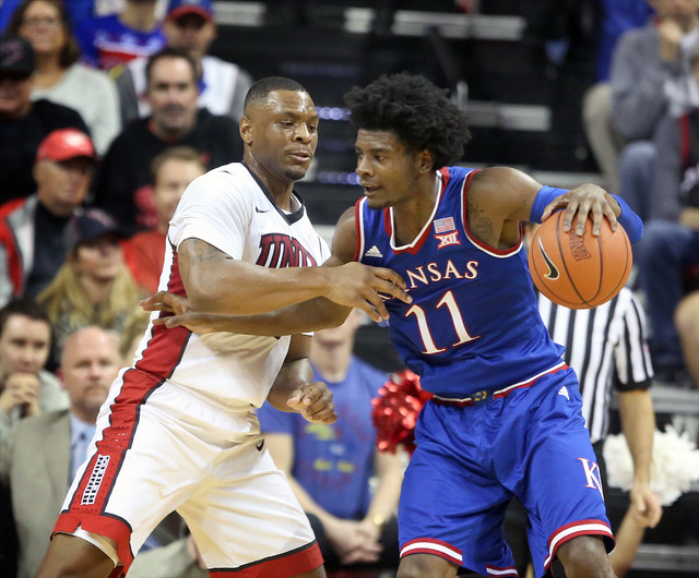 UNLV forward Christian Jones defends Kansas Jayhawks guard Josh Jackson during second half action at the Thomas and Mack Center on Thursday, Dec. 22, 2016. Kansas defeated the Rebels, 71-53. (Jeff ...